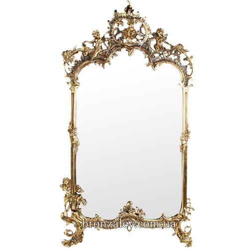 Настенное зеркало, в декоративной бронзовой раме.